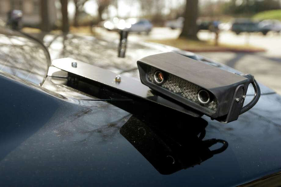 In this photo taken Jan. 16, 2013, a camera is mounted near the rear window of a police car in Little Rock, Ark. The device is part of a system that scans traffic on the streets, relaying the data it collects to a computer for sifting. Police say the surveillance helps identify stolen cars and drivers with outstanding arrest warrants. (AP Photo/Danny Johnston) Photo: Danny Johnston