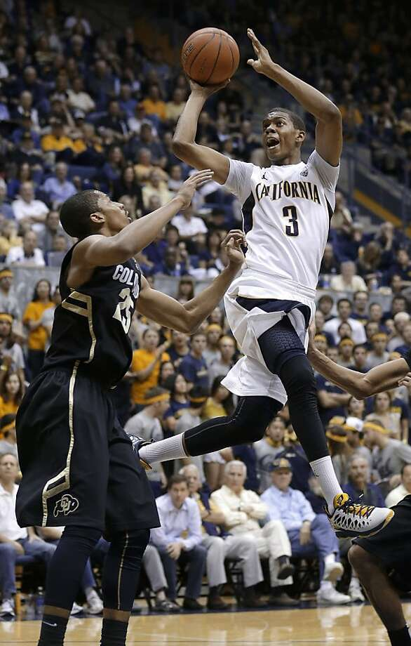 Cal guard Tyrone Wallace shoots over Colorado's Spencer Dinwiddie in the second half. Wallace finished with 16 points. Photo: Jeff Chiu, Associated Press