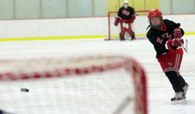 New Canaan's Catherine Granito takes a shot during Saturday's girls hockey state championship game against Hall-Conard at Terry Connors Rink in Stamford, Conn., on March 2, 2013. Photo: Lindsay Perry / Stamford Advocate