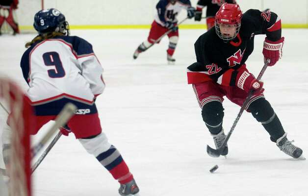 New Canaan's Olivia Hompe takes a shot during Saturday's girls hockey state championship game against Hall-Conard at Terry Connors Rink in Stamford, Conn., on March 2, 2013. Photo: Lindsay Perry / Stamford Advocate
