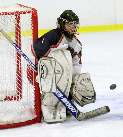 Hall-Conard's Lauren Sogio makes a save during Saturday's girls hockey state championship game against New Canaan at Terry Connors Rink in Stamford, Conn., on March 2, 2013. Photo: Lindsay Perry / Stamford Advocate