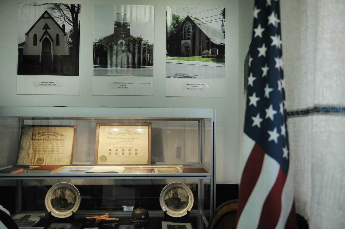 A view of some of the items from various Watervliet churches that are on display as part of an exhibit on the churches of the city at the Watervliet Historical Society on Thursday, Feb. 28, 2013 in Watervliet, NY. (Paul Buckowski / Times Union)