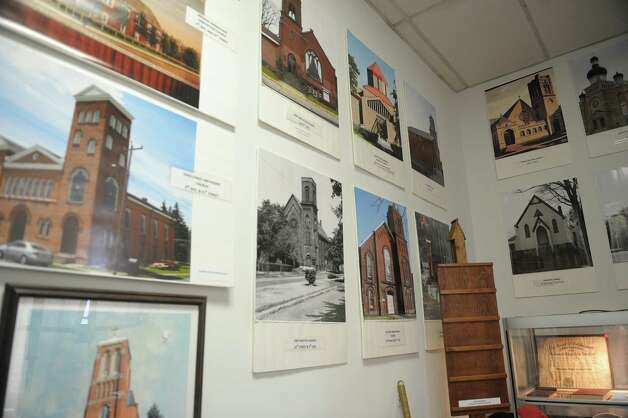 Photographs and painting of various churches are part of the exhibit of Watervliet churches that are on display  at the Watervliet Historical Society on Thursday, Feb. 28, 2013 in Watervliet, NY.  (Paul Buckowski / Times Union) Photo: Paul Buckowski