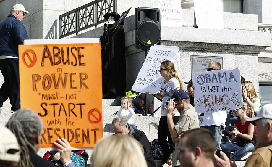 At a rally outside the Utah state Capitol in Salt Lake City, gun rights backers protest President Obama's efforts to limit firearms. Photo: George Frey, Getty Images