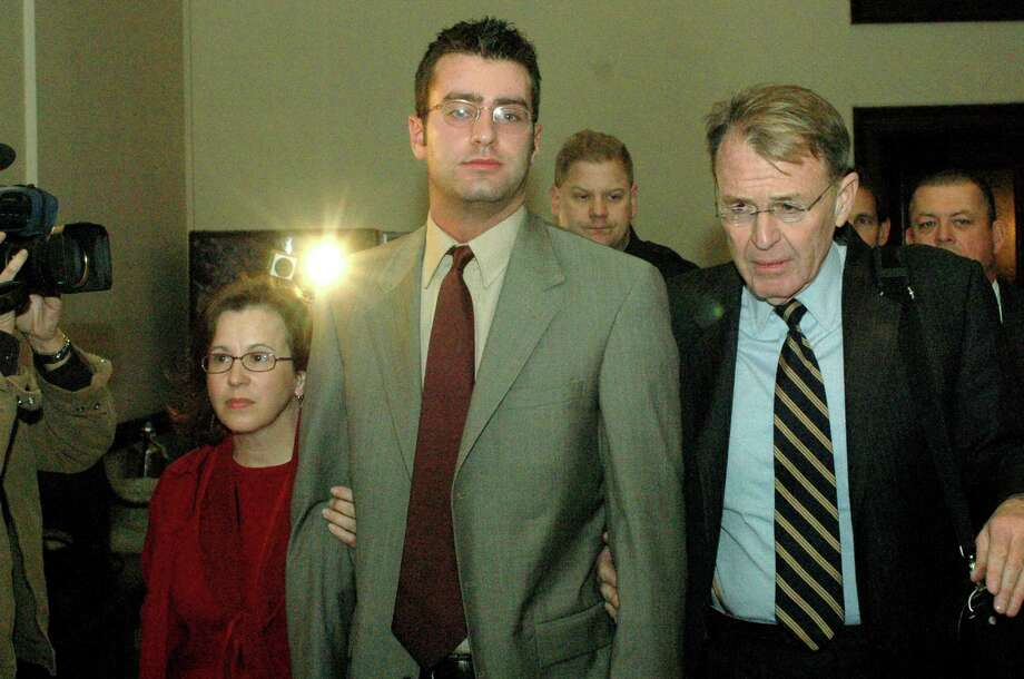 Times Union Staff Photo--Michael P. Farrell--Christopher Porco (center) flanked by Elaine Laforte (left) and defense attorney Terry Kindlon is led into  Albany County Court following a Grand Jury hearing on the murder of his father, Peter Porco, in Albany, New York Friday November 4, 2005. (LYONS STORY) Photo: MICHAEL P. FARRELL / ALBANY TIMES UNION
