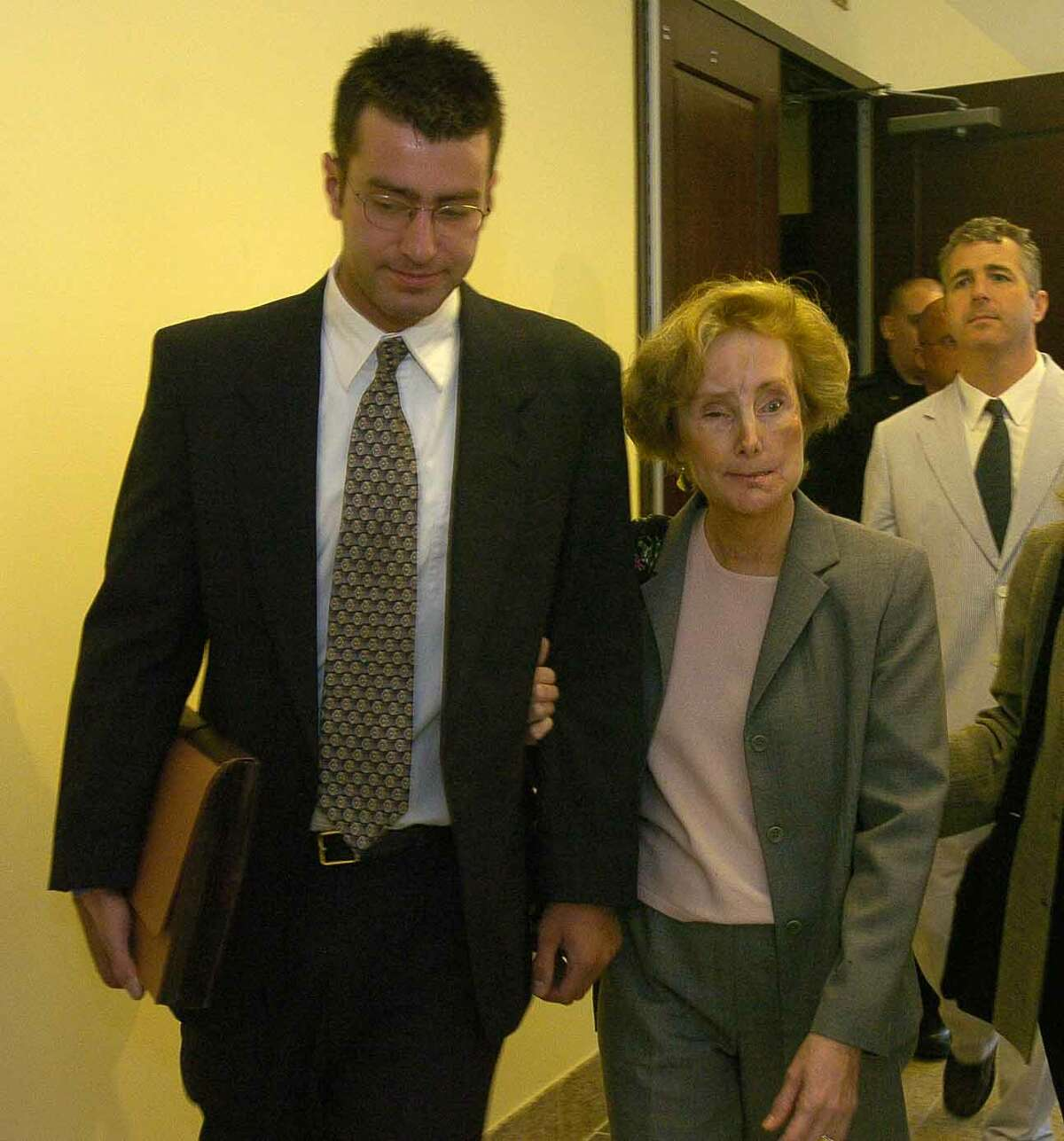 Times Union staff photo by Paul Buckowski --- Christopher Porco, left, and his mother, Joan Porco, right, leave Albany County court in Albany, N.Y. on Tuesday, May 16, 2006 during a break in pretrial hearings. Christopher is charged in the death of his father, Peter Porco and the attack of his mother back November of 2004.