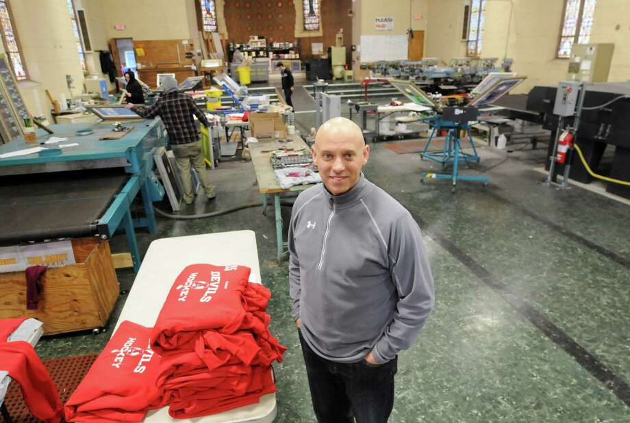 Todd Van Epps, owner of Wicked Smart Apparel which is housed in the former St. Brigid's Church and school Wednesday, Feb. 20, 2013, in Watervliet, N.Y. Wicked Smart Apparel provides clothing customization. (Will Waldron/Times Union) Photo: Will Waldron