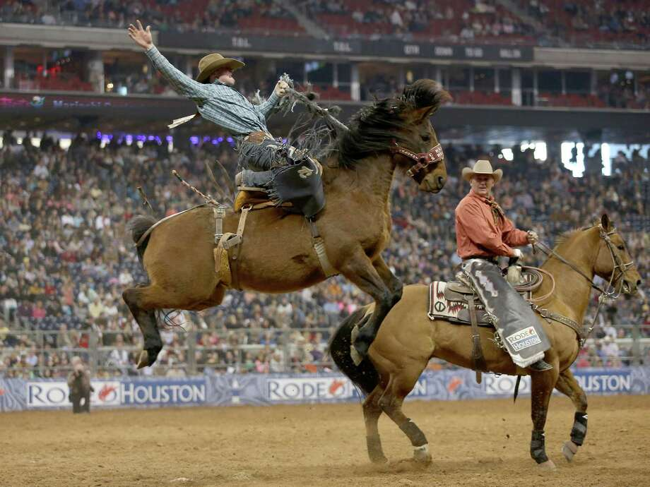 Tyler Corrington scores 86 points in the saddle bronc riding in the Super Series II rodeo competition at Reliant Stadium in Houston, Texas. Photo: Thomas B. Shea, For The Chronicle / © 2012 Thomas B. Shea