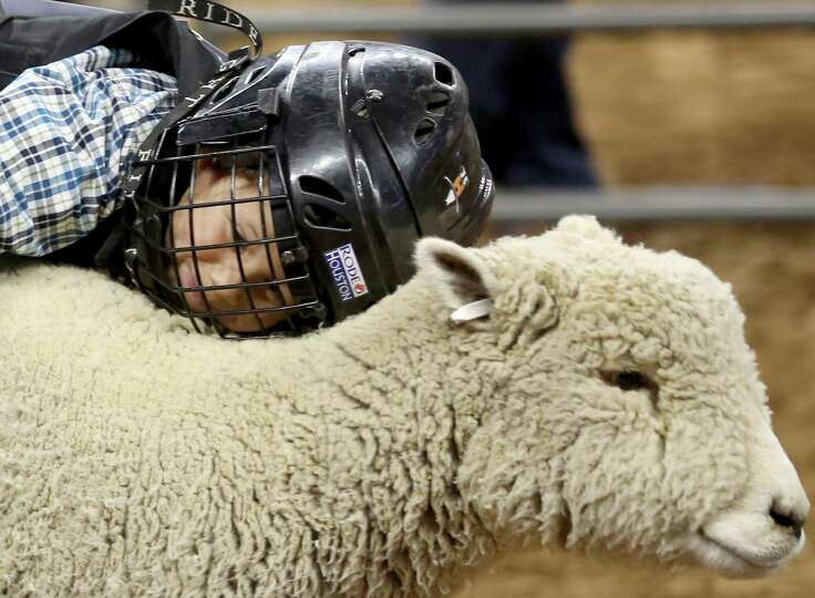 Tyler Hawk, from The Woodlands competes in the mutton busing in the Super Series II rodeo competitio