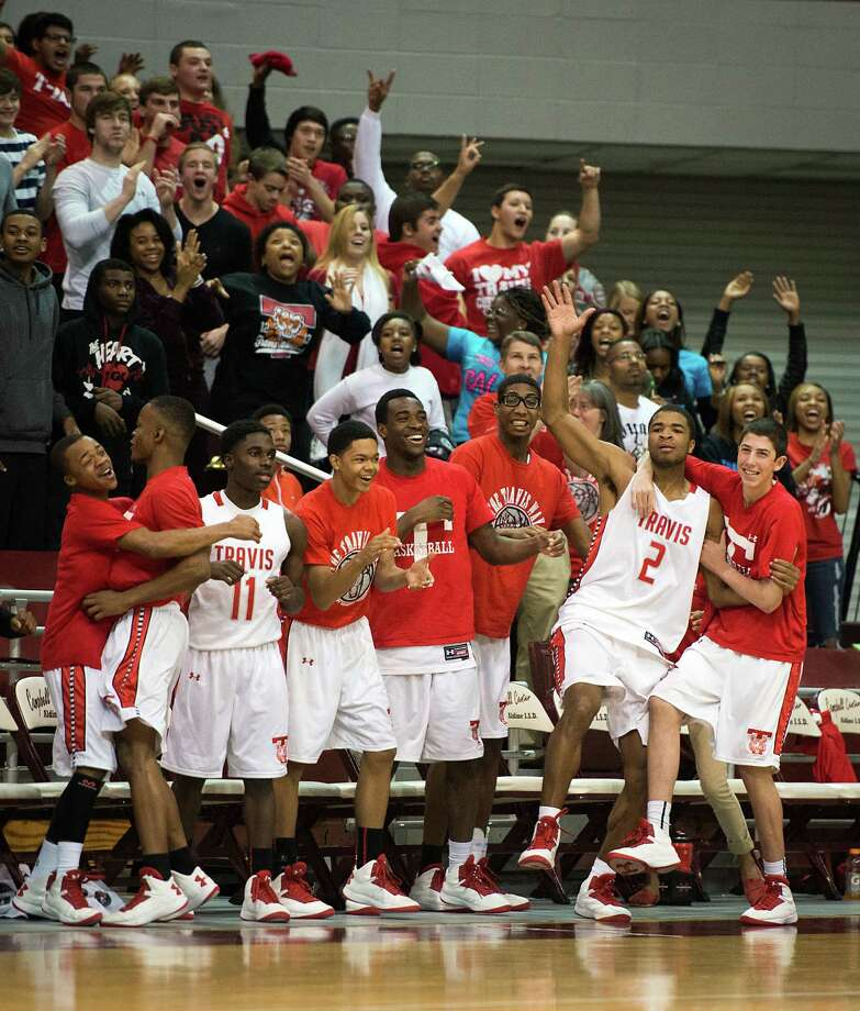 The Travis bench, including guard Aaron Harrison (2), and their fans celebrate their victory over Bush. Photo: Smiley N. Pool, Houston Chronicle / © 2013  Houston Chronicle