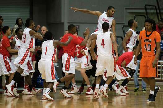 Bush forward Myles Rice walks off the court as Travis players celebrate. Photo: Smiley N. Pool, Houston Chronicle / © 2013  Houston Chronicle