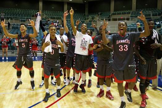 The Terry Rangers celebrate after defeating Georgetown in the 4A Region III tournament at the Merrell Center on Friday, March 1, 2013, in Katy. Photo: J. Patric Schneider, For The Chronicle / © 2013 Houston Chronicle