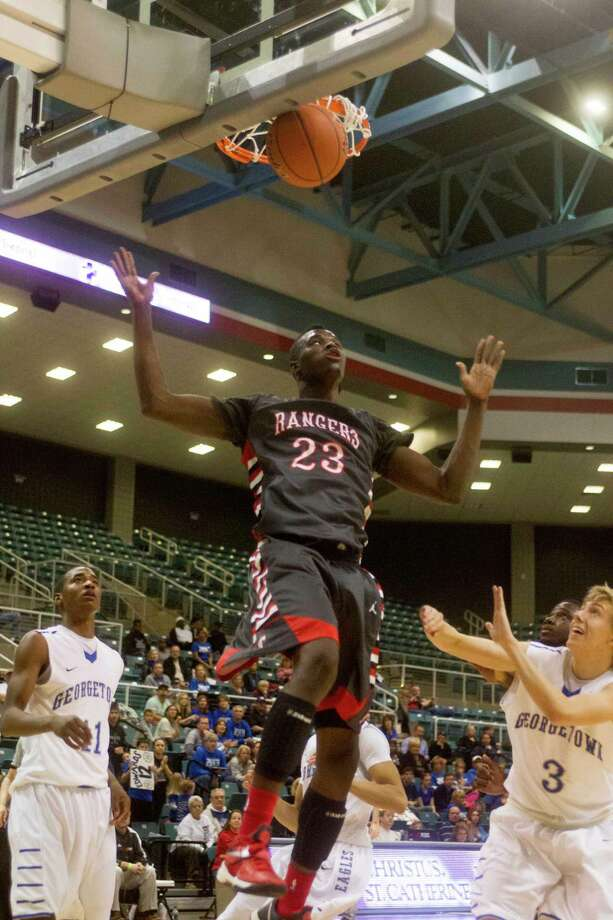 Terry forward Derrick Griffin (23) dunks the ball during the fourth quarter  of the 4A Region III tournament against Georgetown at the Merrell Center on Friday, March 1, 2013, in Katy. Photo: J. Patric Schneider, For The Chronicle / © 2013 Houston Chronicle