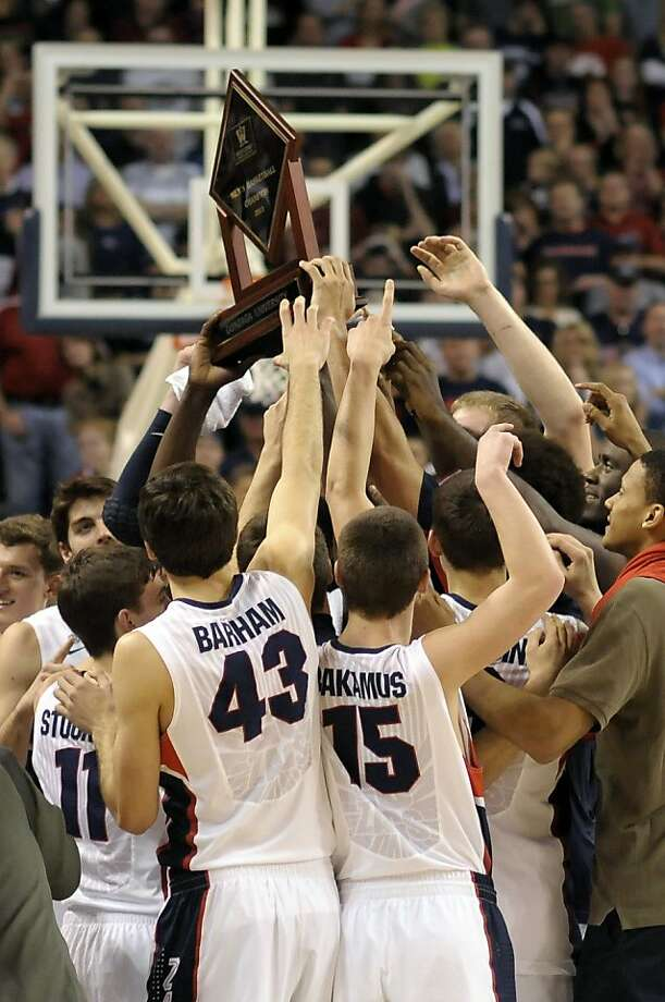 Gonzaga, ranked No. 2 in a week where No. 1 lost, celebrates its regular-season WCC title after routing Portland. Photo: Jed Conklin, Associated Press