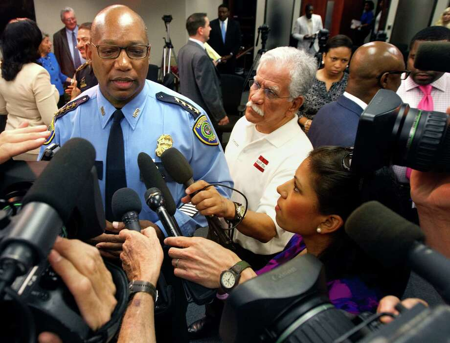 Houston Chief of Police Charles McClelland, left, speaks to the media regarding the arrest of Chad Holley, 18, Thursday, June 14, 2012, in Houston. Holley, a teenager at the center of a controversial police beating case, was arrested on Wednesday in a home burglary in northwest Harris County. Sheriff's deputies arrested Holley, 1after the burglary was reported about 2 p.m. in the 14900 block of Forest Trail. (Cody Duty / Houston Chronicle) Photo: Cody Duty, Staff / © 2011 Houston Chronicle