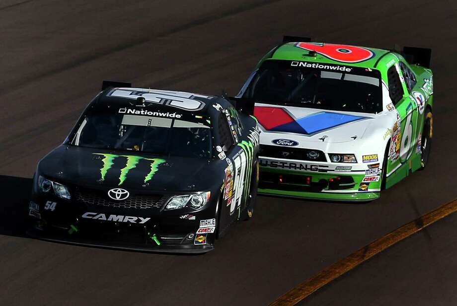 Kyle Busch, driving the No. 54 Monster Toyota, leads Trevor Bayne en route to his victory in the Nationwide Series race in Avondale, Ariz. Photo: Christian Petersen / Getty Images