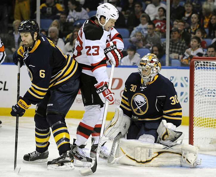 Buffalo Sabres goalie Ryan Miller makes a save on a shot by the New Jersey Devils' David Clarkson (2