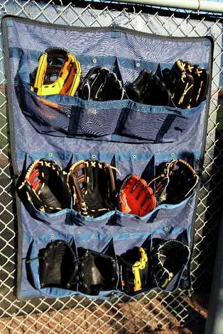 A variety of Rawlings gloves on display for players to choose from. Photo: Karen Warren / © 2013 Houston Chronicle