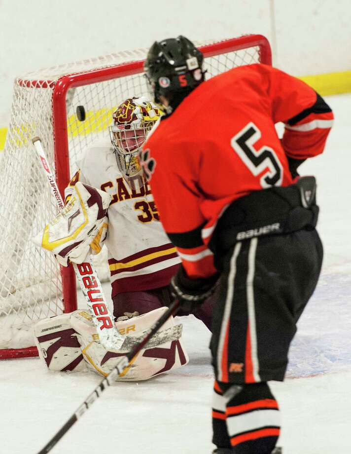Ridgefield high school's #5 Alexander Rowella watches as his teammate Vincent Rella's shot gets past St. Joseph high school goalie Marc VanEtten in the FCIAC boys ice hockey championship game held at Terry Conners Ice Rink, Stamford CT on Saturday, March 2nd, 2013 Photo: Mark Conrad / Connecticut Post Freelance