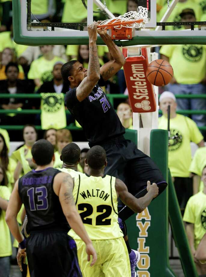Kansas State forward Jordan Henriquez (21) dunks the ball as Angel Rodriguez (13) and Baylor guard A.J. Walton (22) watch in the second half of an NCAA college basketball game on Saturday, March 2, 2013, in Waco, Texas. Kansas State won 64-61. (AP Photo/Tony Gutierrez) Photo: Tony Gutierrez, Associated Press / AP