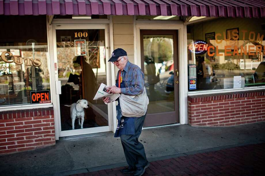 Newt Wallace has had the same paper route in Winters, Calif., since 1947. Once the publisher, he turned the Winters Express over to his son in 1983, but still likes delivering and may be the world's oldest news carrier. Photo: MAX WHITTAKER, STR / NYTNS