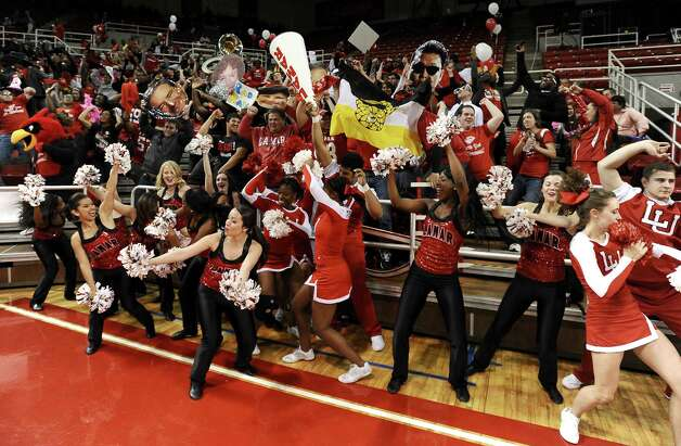 Lamar University student section performs their rendition of the Harlem Shake at the Montagne Center on Saturday, March 2, 2013. Photo taken: Randy Edwards/The Enterprise