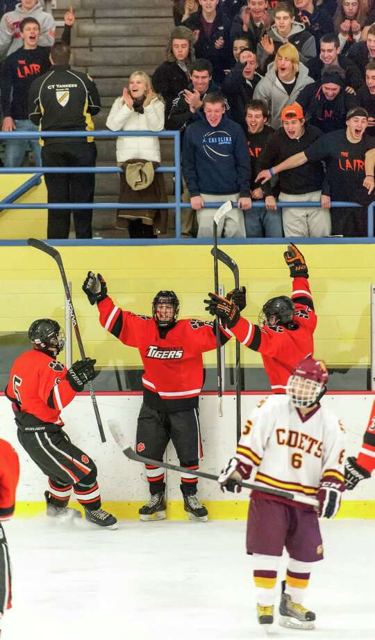 Ridgefield high school's Alexander Rowella, Liam Smith, and Christopher Morrow celebrate a goal by their team in the FCIAC boys ice hockey championship game against St. Joseph high school held at Terry Conners Ice Rink, Stamford CT on Saturday, March 2nd, 2013 Photo: Mark Conrad / Connecticut Post Freelance