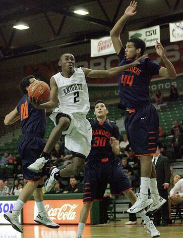 Steele's C.J. Siples cuts in the paint against   Brandeis' Shawn Guerrero, Matt Kallead and Jonathan Robinson  during the boys 5A Regional Finals at The University of Texas Pan American Fieldhouse in Edinburg on Saturday, March 2,2013. Steele defeated Brandies 71-67 to advance to state finals. Photo: Delcia Lopez, Delcia Lopez / For The Express-News
