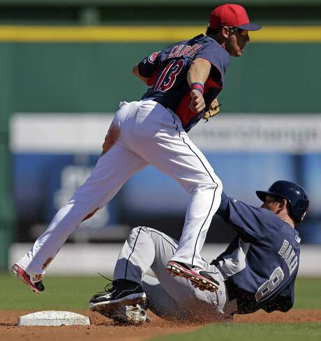 Indians shortstop Asdrubal Cabrera (left) tries to turn a double play while forcing out John Baker at second on a ball hit by former Missions player Jaff Decker in the Padres' win Saturday. Photo: Charlie Riedel / Associated Press