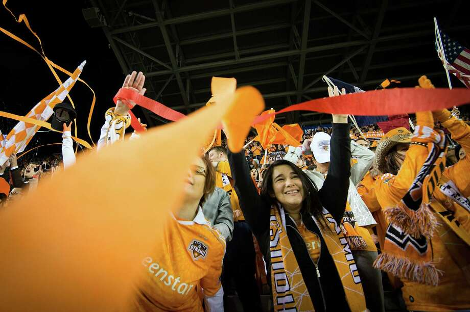 Dynamo fans cheer as their team takes the field for the season opener against D.C. United. Photo: Smiley N. Pool, Houston Chronicle / © 2013  Houston Chronicle