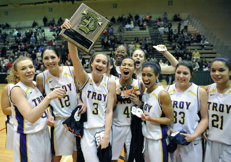 Troy players celebrate their win over  Holy Names for the Class A girls' basketball title at HVCC Sa