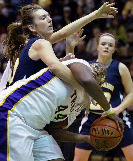 Troy's #44 Cheyenne Williams and Holy Names' #10 Mary Kate Murray, left, fight for a rebound during
