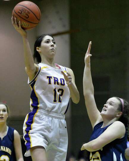 Troy's #12 Courtney Avery, left, and Holy Names' #22 Sally O'Toole during the Class A girls' basketb