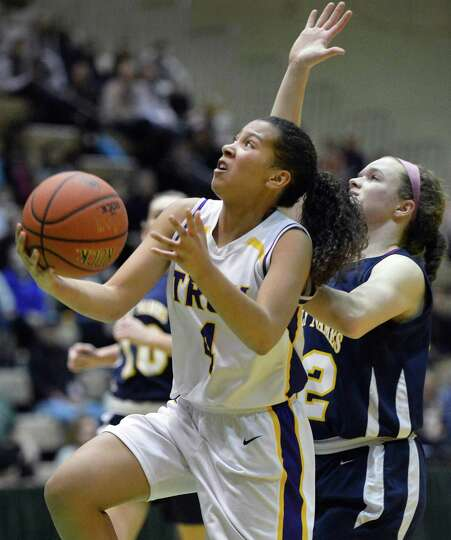 Troy's #4 Kiana Patterson, left, and Holy Names' #22 Sally O'Toole during the Class A girls' basketb