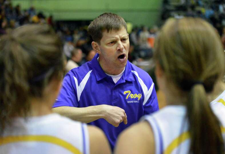 Troy head coach Roger Anderson with players during their Class A girls' basketball title game agains