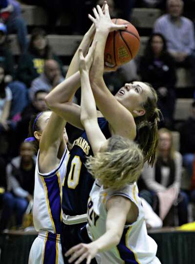 Holy Names' #10 Mary Kate Murray gts double teamed under the basket by Troy'defenders during the Cla