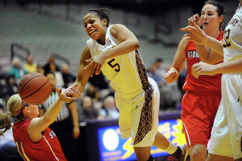 UAlbany's Ebone Henry (5), center, looses the ball and goes airborne when Stony Brook's Dani Klupeng