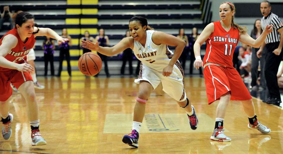 UAlbany's Ebone Henry (5), center, steals the ball from Stony Brook's Dani Klupenger (11), right, du