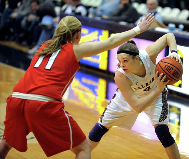 UAlbany's Sarah Royals (4), right, looks to pass as Stony Brook's Dani Klupenger (11) defends during