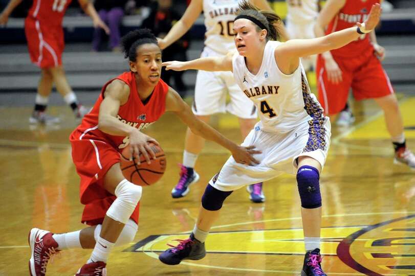 UAlbany's Sarah Royals (4), right, guards against Stony Brook's Gerda Gatling (5) during their baske
