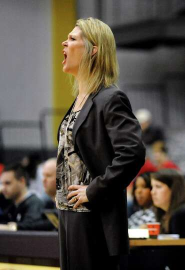 UAlbany's coach Katie Abrahamson-Henderson instructs her team during their basketball game against S