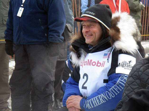 Four-time champion Martin Buser waits for the ceremonial start of the 2013 Iditarod Trail Sled Dog Race in Anchorage, Alaska on Saturday, March 2, 2013. The race, which will take mushers and dog teams about a thousand miles across the Alaska wilderness, starts Sunday, March 3, 2013, in Willow, Alaska. (AP Photo/Mark Thiessen) Photo: Mark Thiessen