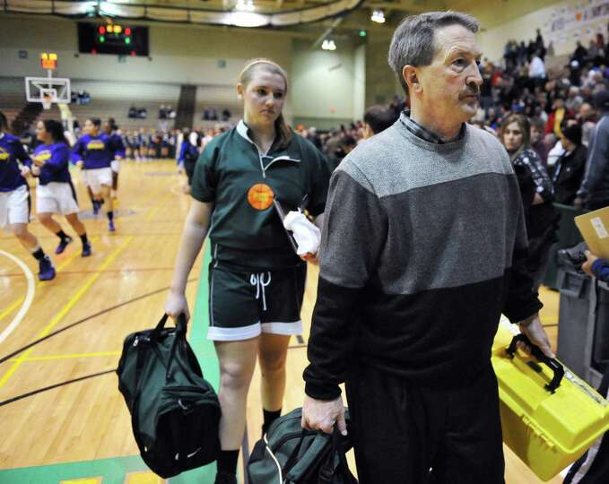 Ravena coach Bruce Stott leaves the court for the last time after their loss to Watervliet in the Cl
