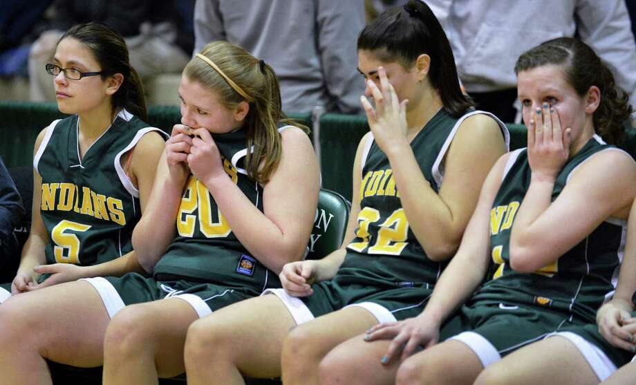 Ravena palyers react to their loss to Watervliet in the Class B girls' final at HVCC Saturday March 2, 2013.  (John Carl D'Annibale / Times Union) Photo: John Carl D'Annibale / 10021374A
