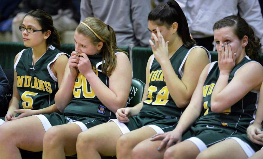 Ravena palyers react to their loss to Watervliet in the Class B girls' final at HVCC Saturday March