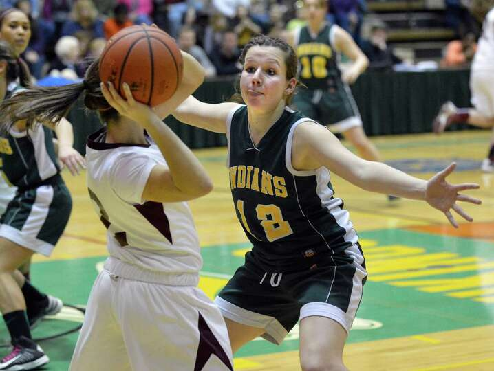 Ravena 's #12 Olivia Vosburgh guards Watervliet's #2 Shelby Dugan, left, during the Class B girls' f