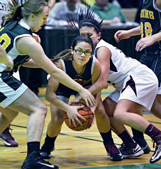 Ravena 's #5 Jasmine Powell, center, during the Class B girls' final against