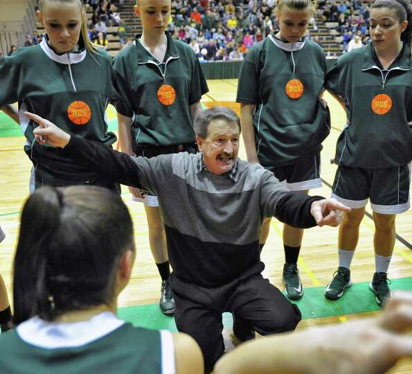 Ravena coach Bruce Stott with players during a time out in their Class B girls' final against Waterv