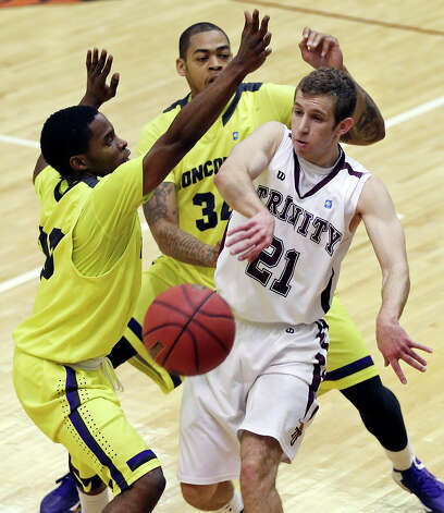 Trinity's Craig Saltarelli passes around Concordia's Larry Durand (left) and Concordia's Darien Harris during first half action Saturday March 2, 2013 at Sams Gym on the Trinity University campus. Photo: Edward A. Ornelas, San Antonio Express-News / © 2013 San Antonio Express-News