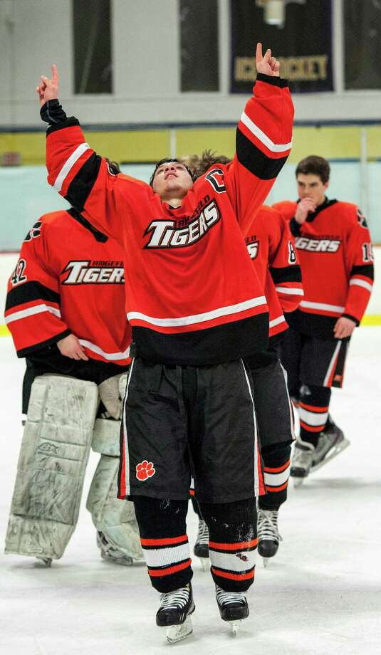 Ridgefield high school's Vincent Rella celebrates winning the FCIAC boys ice hockey championship game against St. Joseph high schoolheld at Terry Conners Ice Rink, Stamford CT on Saturday, March 2nd, 2013 Photo: Mark Conrad / Connecticut Post Freelance